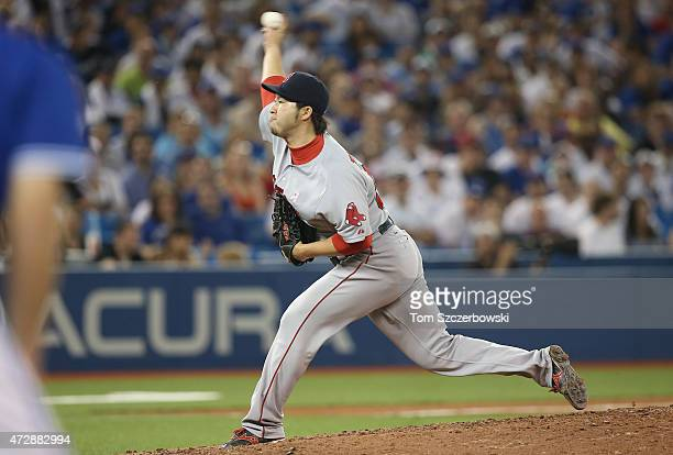 Junichi Tazawa of the Boston Red Sox delivers a pitch in the eighth inning during MLB game action against the Toronto Blue Jays on May 10 2015 at...