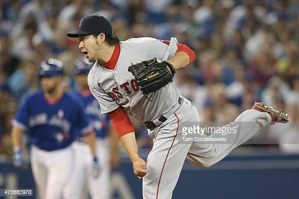 Junichi Tazawa of the Boston Red Sox delivers a pitch in the seventh inning during MLB game action against the Toronto Blue Jays on May 10 2015 at...