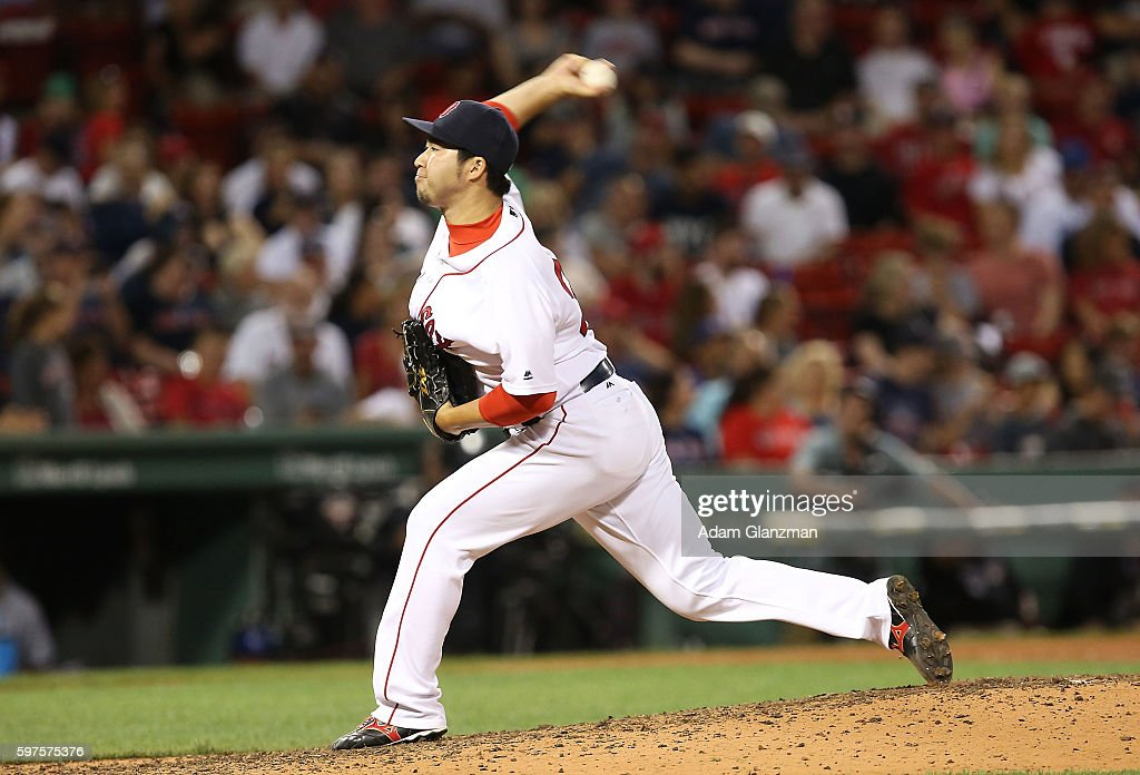 Junichi Tazawa #36 of the Boston Red Sox delivers in the eighth inning during a game against the Kansas City Royals on August 28, 2016 at Fenway Park in Boston, Massachusetts.