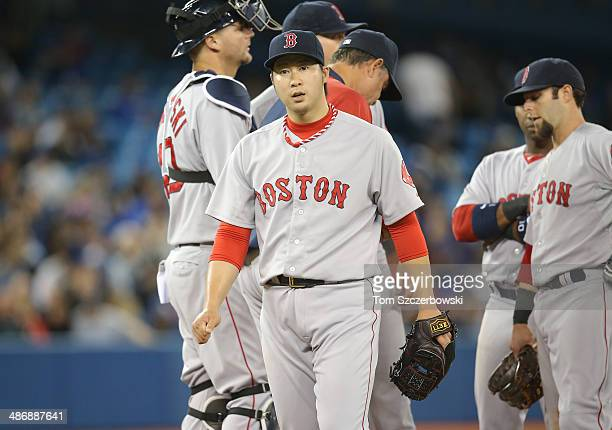 Junichi Tazawa of the Boston Red Sox exits the game after being relieved in the eighth inning during MLB game action against the Toronto Blue Jays on...