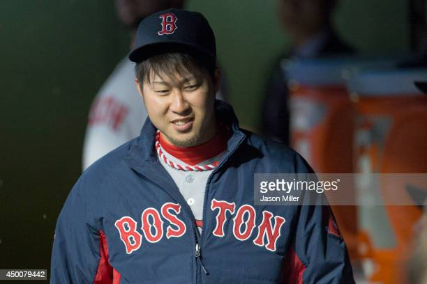 Junichi Tazawa of the Boston Red Sox in the dugout prior to the game against the Cleveland Indians at Progressive Field on June 4, 2014 in Cleveland,...