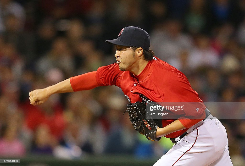 Junichi Tazawa #36 of the Boston Red Sox in the eighth inning against Oakland Athletics at Fenway Park on June 5, 2015 in Boston, Massachusetts.