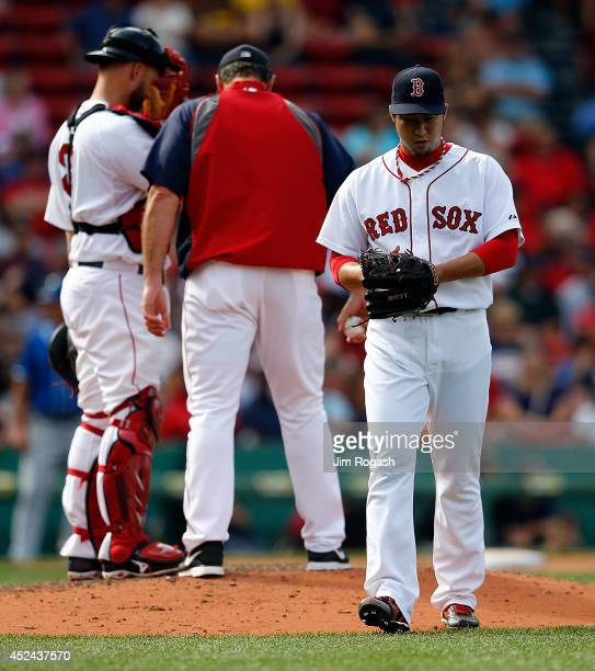 Junichi Tazawa of the Boston Red Sox is relieved in the ninth inning against the Kansas City Royals at Fenway Park on July 20 2014 in Boston...