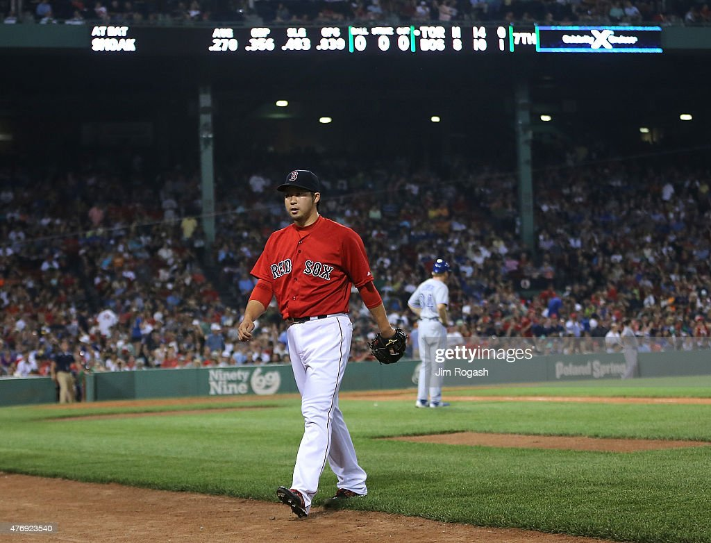 Junichi Tazawa #36 of the Boston Red Sox leaves after giving up a three-run triple in the seventh inning against Toronto Blue Jays at Fenway Park on June 12, 2015 in Boston, Massachusetts.