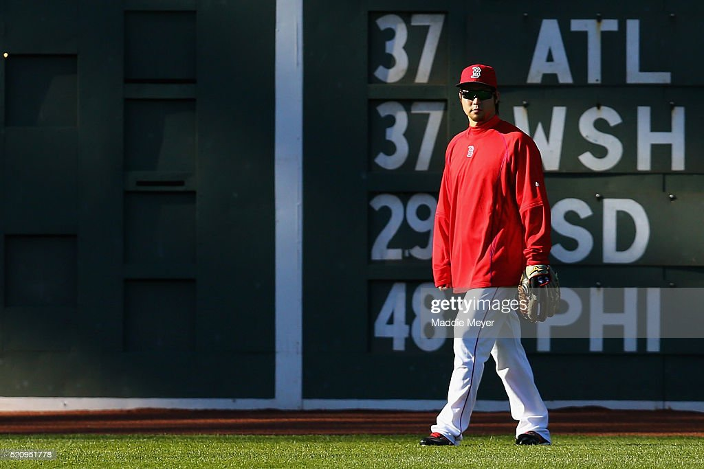 Junichi Tazawa #36 of the Boston Red Sox looks on during batting practice before the game against the Baltimore Orioles at Fenway Park on April 13, 2016 in Boston, Massachusetts.