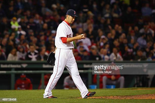 Junichi Tazawa of the Boston Red Sox looks on in between pitches against the Washington Nationals during the eighth inning at Fenway Park on April 14...
