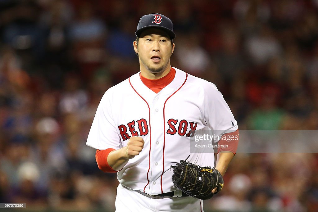 Junichi Tazawa #36 of the Boston Red Sox looks on in the eighth inning during a game against the Kansas City Royals on August 28, 2016 at Fenway Park in Boston, Massachusetts.