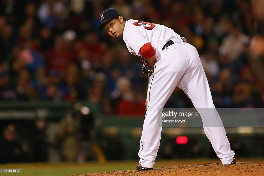 Junichi Tazawa #36 of the Boston Red Sox looks towards first during the eighth inning against the Toronto Blue Jays at Fenway Park on April 29, 2015 in Boston, Massachusetts.