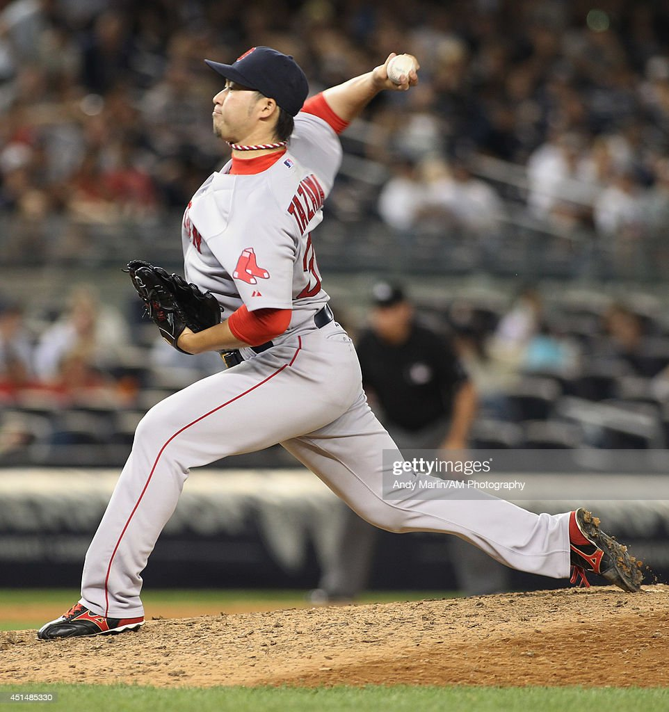Junichi Tazawa #36 of the Boston Red Sox pitches against the New York Yankees at Yankee Stadium on June 29, 2014 in the Bronx borough of New York City. The Red Sox defeated the Yankees 8-5.
