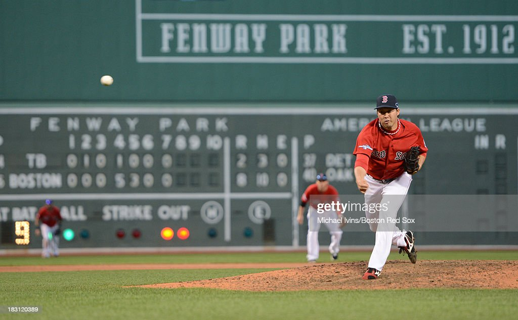 Junichi Tazawa #36 of the Boston Red Sox pitches against the Tampa Bay Rays during the eighth inning of Game One of the American League Division Series on October 4, 2013 at Fenway Park in Boston, Massachusetts.
