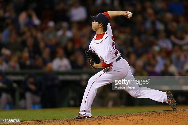 Junichi Tazawa of the Boston Red Sox pitches against the Tampa Bay Rays during the seventh inning at Fenway Park on May 6 2015 in Boston Massachusetts