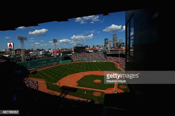 Junichi Tazawa of the Boston Red Sox pitches against the Tampa Bay Rays during the eighth inning at Fenway Park on August 2 2015 in Boston...