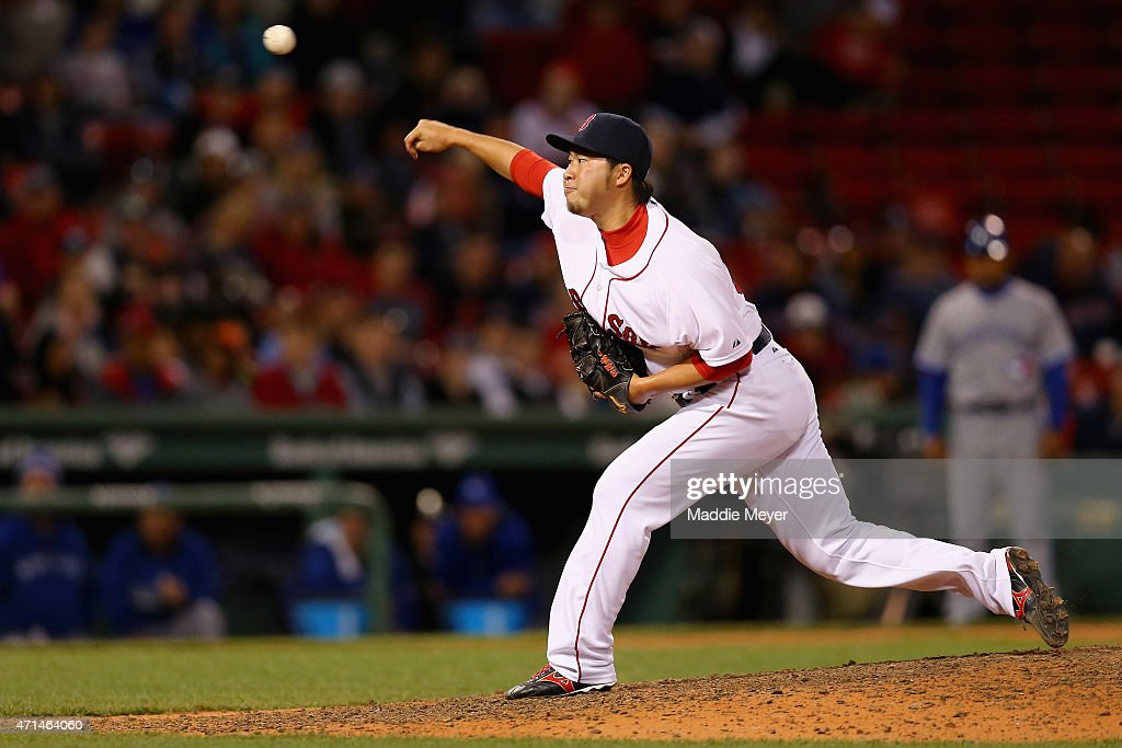 Junichi Tazawa #36 of the Boston Red Sox pitches against the Toronto Blue Jays during the ninth inning at Fenway Park on April 28, 2015 in Boston, Massachusetts.