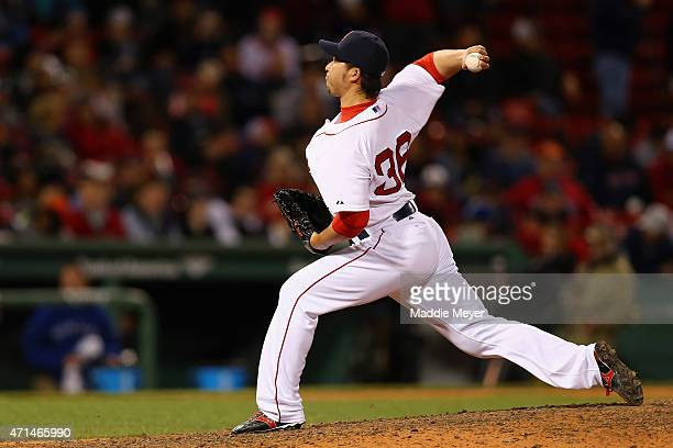 Junichi Tazawa of the Boston Red Sox pitches against the Toronto Blue Jays during the ninth inning at Fenway Park on April 28 2015 in Boston...