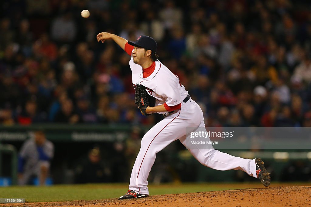 Junichi Tazawa #36 of the Boston Red Sox pitches against the Toronto Blue Jays during the eighth inning at Fenway Park on April 29, 2015 in Boston, Massachusetts.