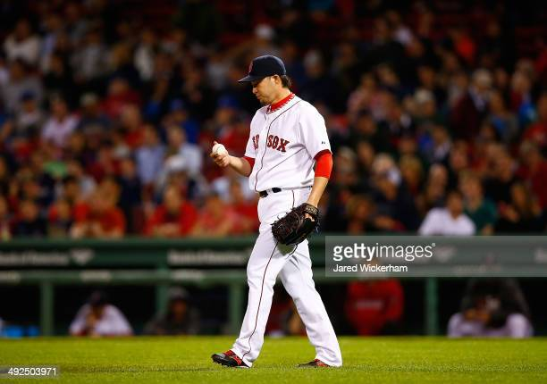 Junichi Tazawa of the Boston Red Sox pitches against the Toronto Blue Jays in the ninth inning during the game at Fenway Park on May 20 2014 in...