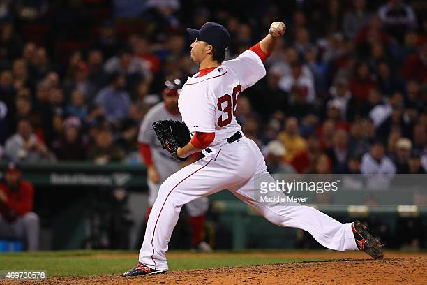 Junichi Tazawa of the Boston Red Sox pitches against the Washington Nationals during the eighth inning at Fenway Park on April 14 2015 in Boston...
