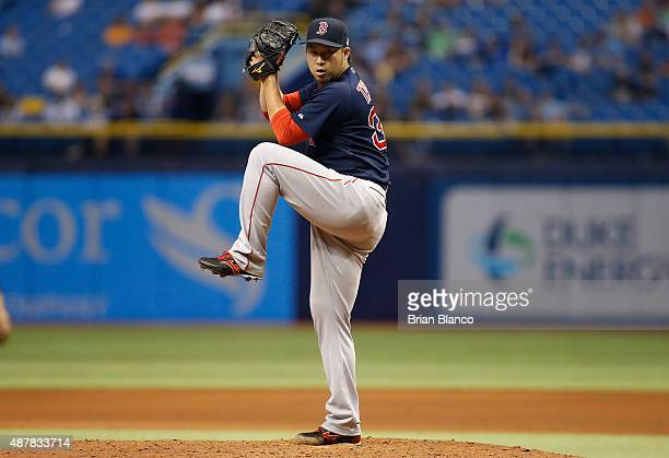 Junichi Tazawa of the Boston Red Sox pitches during the eighth inning of a game against the Tampa Bay Rays on September 11 2015 at Tropicana Field in...