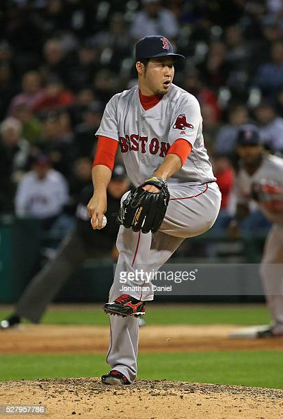 Junichi Tazawa of the Boston Red Sox pitches in the 8th inning against the Chicago White Sox at US Cellular Field on May 3 2016 in Chicago Illinois...