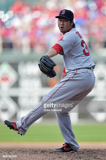 Junichi Tazawa of the Boston Red Sox pitches in the eighth inning against the Philadelphia Phillies during Opening Day at Citizens Bank Park on April...