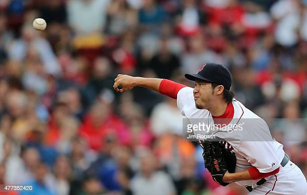 Junichi Tazawa of the Boston Red Sox pitches in the eighth inning against the Atlanta Braves at Fenway Park on June 16, 2015 in Boston, Massachusetts.