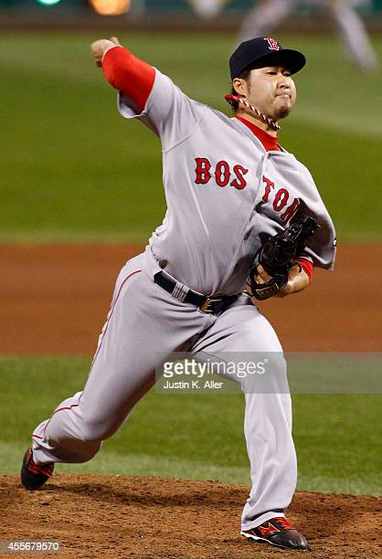 Junichi Tazawa of the Boston Red Sox pitches in the seventh inning during interleague play against the Pittsburgh Pirates at PNC Park on September 18...