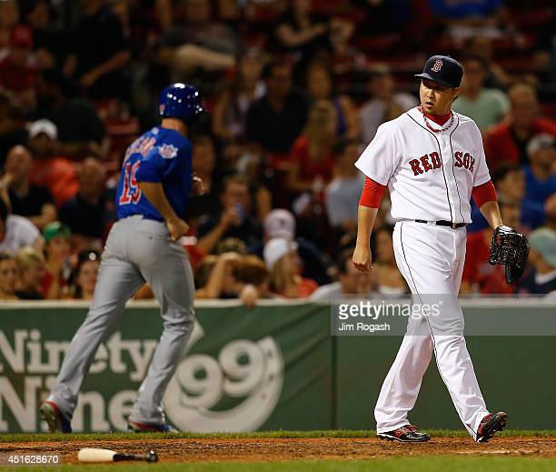 Junichi Tazawa of the Boston Red Sox reacts after he allowed a run to score in the ninth inning against the Chicago Cubs at Fenway Park on July 2...