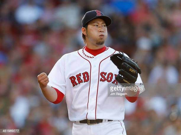 Junichi Tazawa of the Boston Red Sox reacts after pitching a scoreless eighth inning against the Chicago White Sox at Fenway Park on July 10 2014 in...
