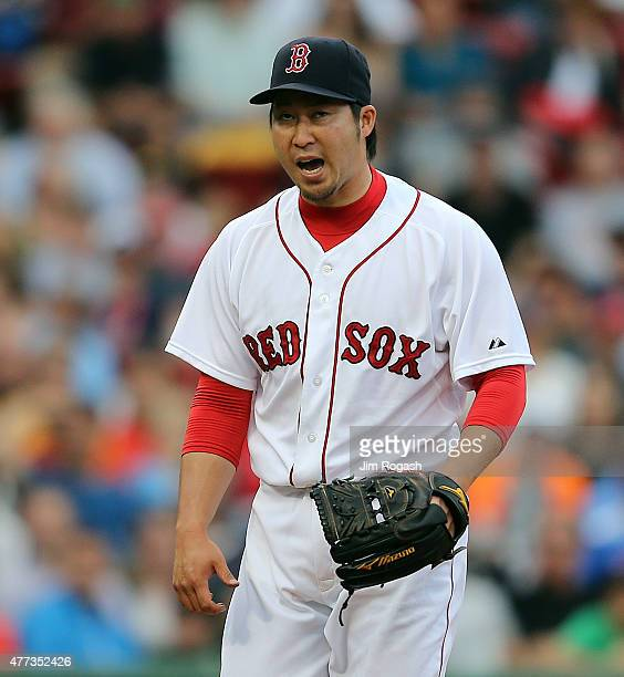 Junichi Tazawa of the Boston Red Sox reacts after pitching a scoreless eighth inning against the Atlanta Braves at Fenway Park on June 16, 2015 in...