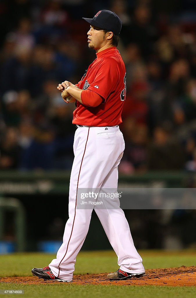 Junichi Tazawa #36 of the Boston Red Sox reacts after served Alex Rodriguez #13 of the New York his 660th career home run to tie Willie Mays in the 8th inning at Fenway Park May 1, 2015 in Boston, Massachusetts.