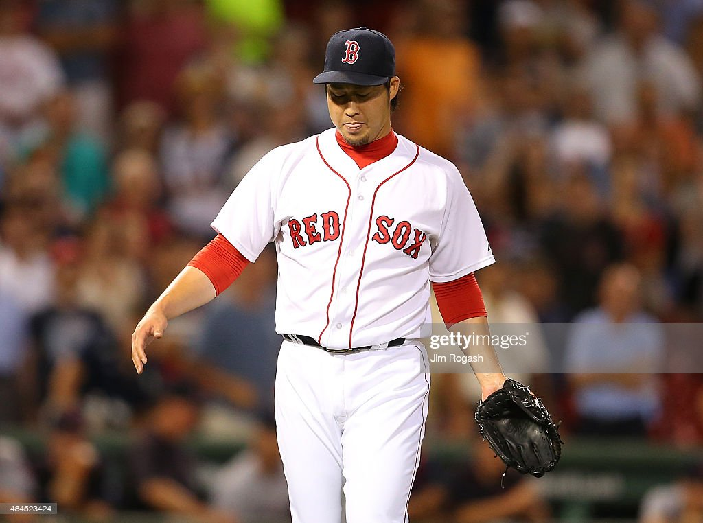 Junichi Tazawa #36 of the Boston Red Sox reacts after the the final out in the ninth inning against the Cleveland Indians on August 19, 2015 in Boston, Massachusetts.