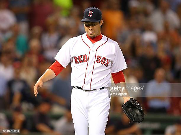 Junichi Tazawa of the Boston Red Sox reacts after the the final out in the ninth inning against the Cleveland Indians on August 19 2015 in Boston...