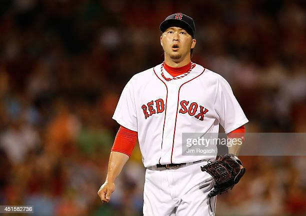 Junichi Tazawa of the Boston Red Sox reacts after throwing a scoreless eighth inning against the Chicago Cubs at Fenway Park on July 1 2014 in Boston...