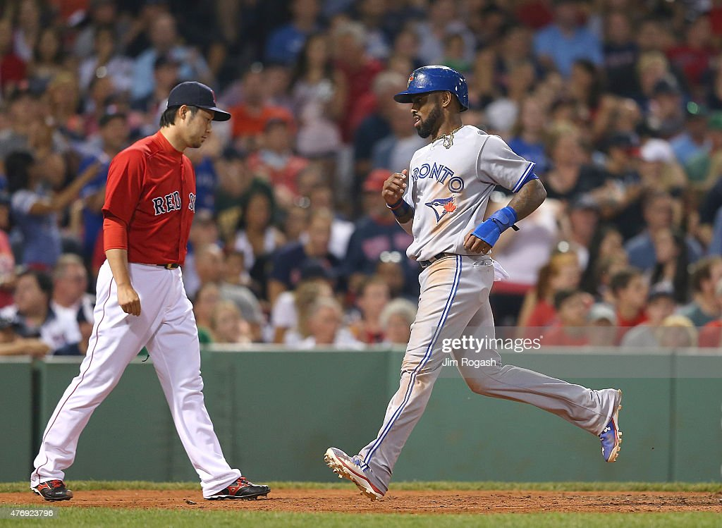 Junichi Tazawa #36 of the Boston Red Sox reacts in the seventh inning as Jose Bautista #19 of the Toronto Blue Jays scores a run at Fenway Park on June 12, 2015 in Boston, Massachusetts.