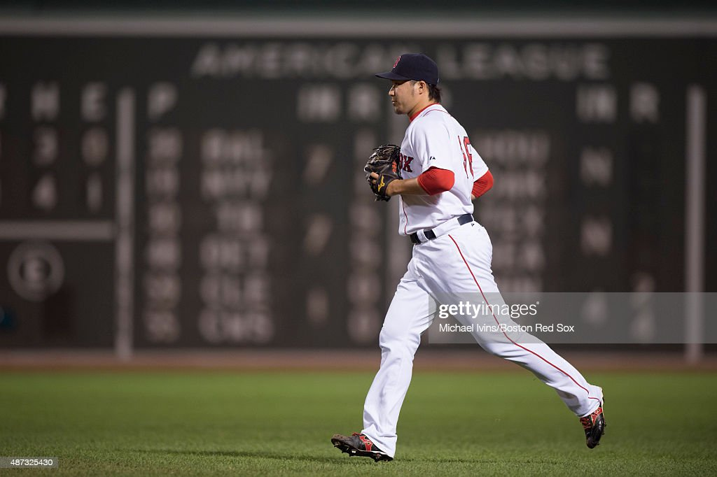 Junichi Tazawa #36 of the Boston Red Sox runs to the mound to pitch against the Toronto Blue Jays during the eighth at Fenway Park on September 8, 2015 in Boston, Massachusetts.