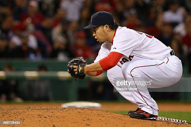 Junichi Tazawa of the Boston Red Sox stretches in between pitches against the Washington Nationals during the eighth inning at Fenway Park on April...