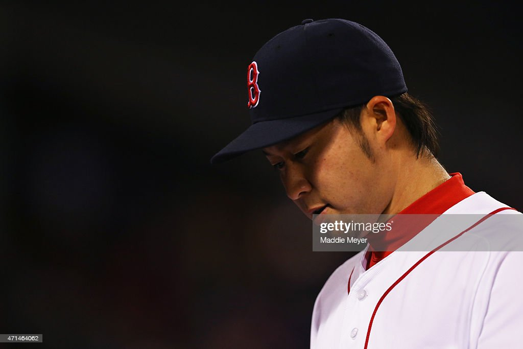 Junichi Tazawa #36 of the Boston Red Sox talks to the dugout during the ninth inning against the Toronto Blue Jays at Fenway Park on April 28, 2015 in Boston, Massachusetts.