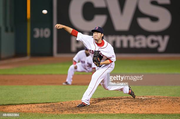 Junichi Tazawa of the Boston Red Sox throws a pitch during the ninth inning against the Kansas City Royals at Fenway Park on August 20 2015 in Boston...
