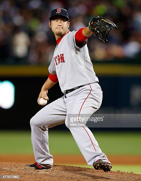 Junichi Tazawa of the Boston Red Sox throws a pitch in the seventh inning during the game against the Atlanta Braves at Turner Field on June 17 2015...
