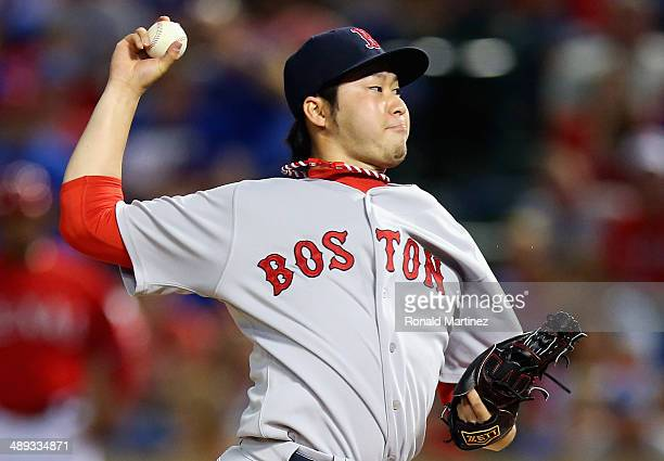 Junichi Tazawa of the Boston Red Sox throws against the Texas Rangers in the 8th inning at Globe Life Park in Arlington on May 10 2014 in Arlington...