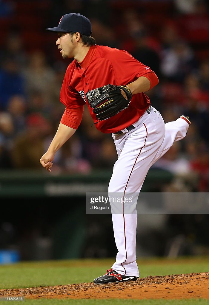 Junichi Tazawa #36 of the Boston Red Sox throws in the eighth inning against the New York Yankees at Fenway Park May 1, 2015 in Boston, Massachusetts.