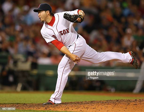 Junichi Tazawa of the Boston Red Sox throws in the eighth inning against the Chicago White Sox at Fenway Park on July 27, 2015 in Boston,...