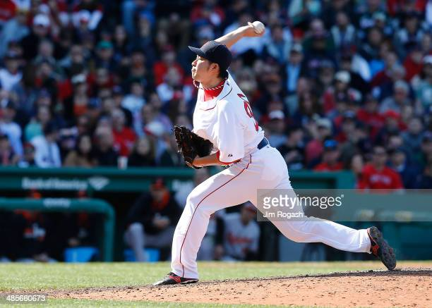 Junichi Tazawa of the Boston Red Sox throws in the eighth inning against the Baltimore Orioles, on the way to a 4-2 win, at Fenway Park on April 19,...