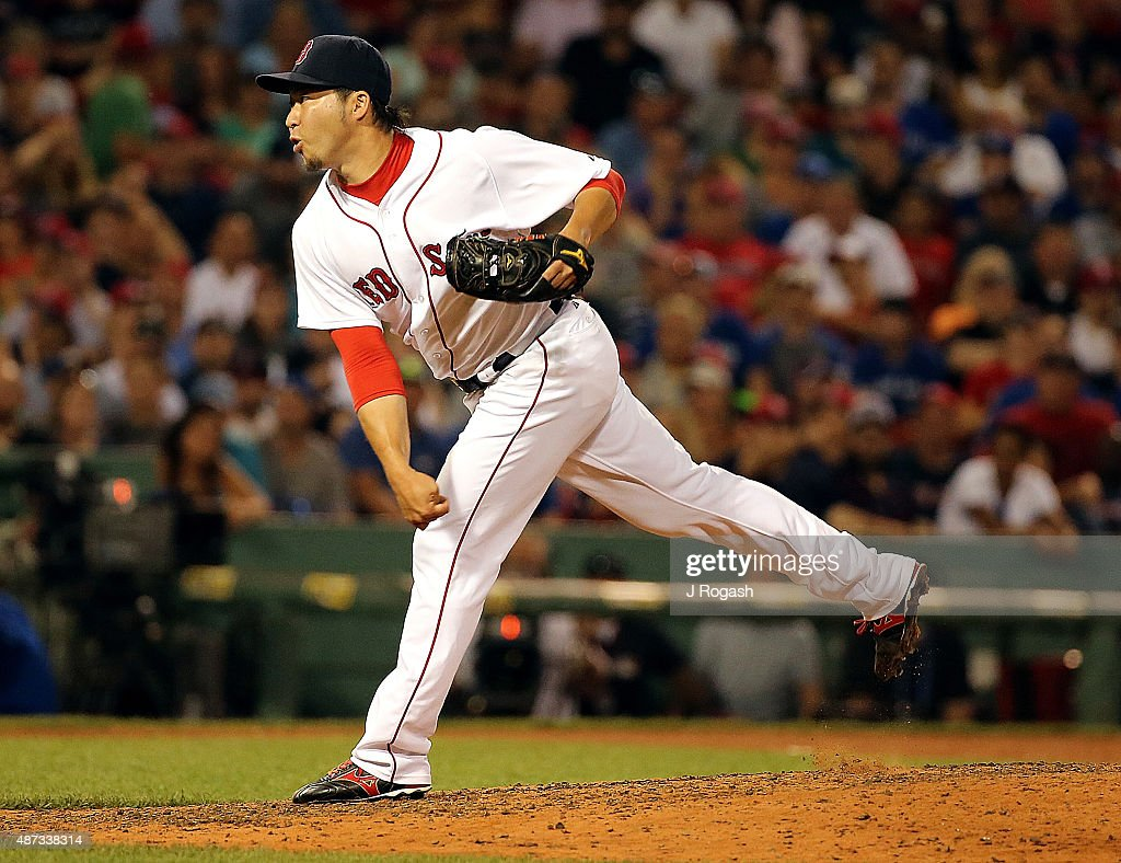 Junichi Tazawa #36 of the Boston Red Sox throws in the eighth inning against the Toronto Blue Jay at Fenway Park on September 8, 2015 in Boston, Massachusetts.