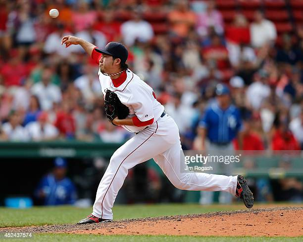 Junichi Tazawa of the Boston Red Sox throws in the ninth inning against the Kansas City Royals at Fenway Park on July 20 2014 in Boston Massachusetts