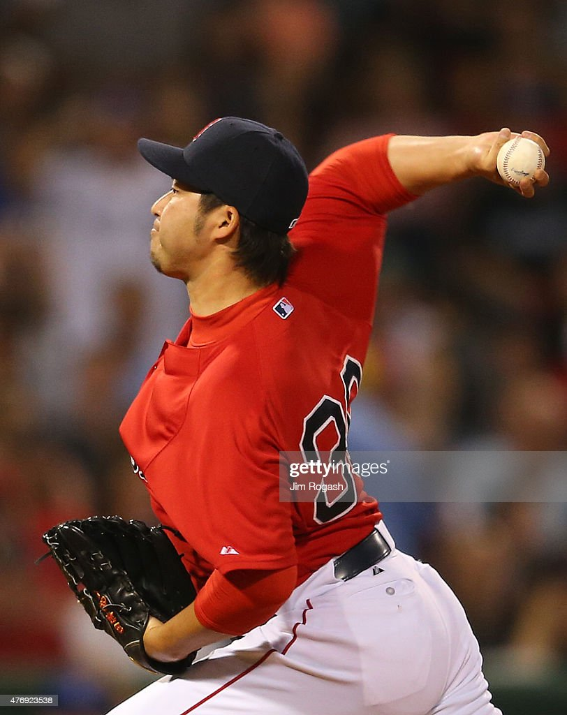 Junichi Tazawa #36 of the Boston Red Sox throws in the seventh inning against Toronto Blue Jays at Fenway Park on June 12, 2015 in Boston, Massachusetts.