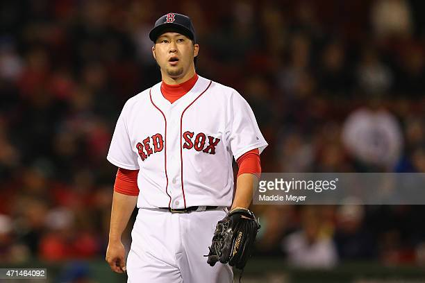 Junichi Tazawa of the Boston Red Sox walks to the dugout during the ninth inning against the Toronto Blue Jays at Fenway Park on April 28 2015 in...