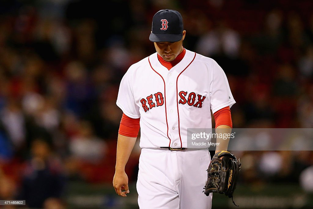 Junichi Tazawa #36 of the Boston Red Sox walks to the dugout during the ninth inning against the Toronto Blue Jays at Fenway Park on April 28, 2015 in Boston, Massachusetts.