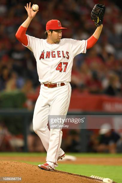 Junichi Tazawa of the Los Angeles Angels of Anaheim calls for a new ball in the ninth inning against the Seattle Mariners at Angel Stadium on...