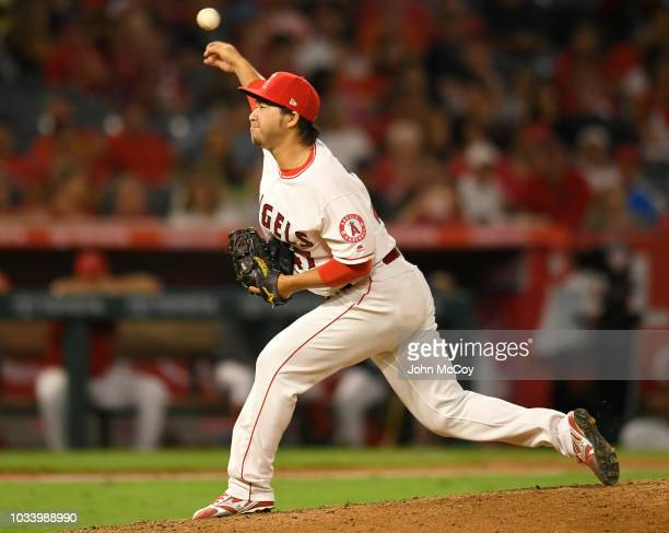 Junichi Tazawa of the Los Angeles Angels of Anaheim pitches against the Seattle Mariners in the eighth inning at Angel Stadium on September 15 2018...
